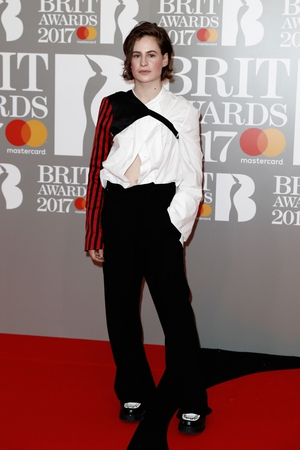 French singer Christine and the Queens in an original combo of sleeves.