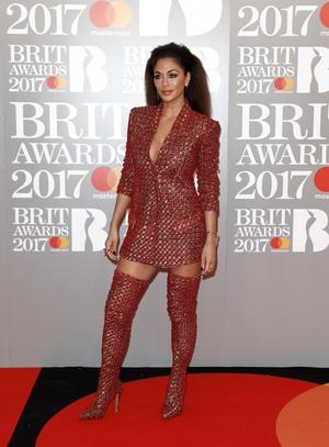 Singer Nicole Scherzinger sizzled in red thigh high boots.