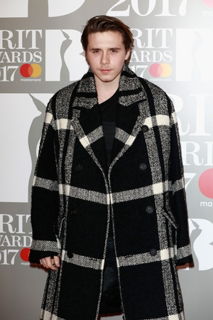 Brooklyn Beckham in a very prominent coat! How grown up does he look?!
