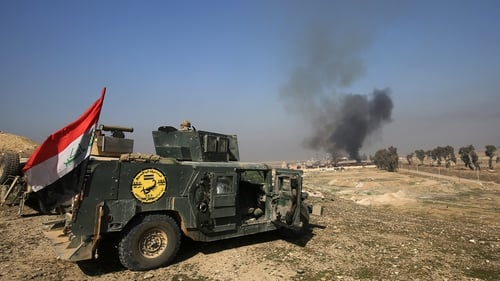 Smoke billows as Iraqi forces gather at Mosul airport during an offensive to retake the western side of the city
