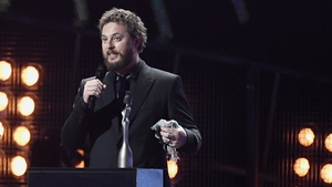 David Bowie's son Duncan Jones accepting one of his late Dad's awards at the Brits