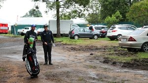 Paul Dunne contemplates a shot from a car park at the first today