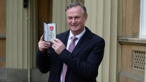 Michael O'Neill poses with his medal
