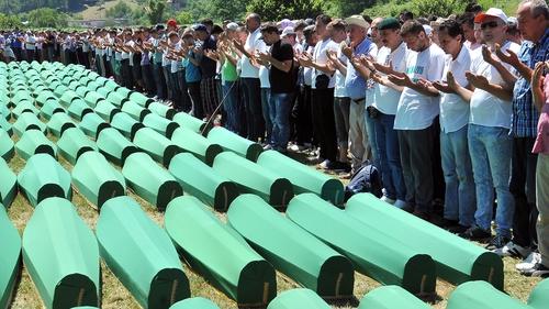 Survivors of Srebrenica's 1995 massacre pray for their relatives, at a memorial cemetery in Potocari in July 2016