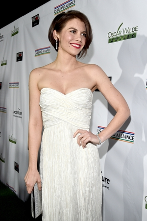 Lauren Cohan is Hollywood glamour in this strapless white dress and stunning red lip.