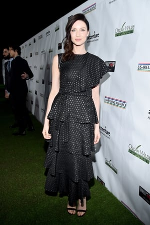 Caitriona Balfe looks fabulous in frills. We have a feeling one shoulder dresses are the trend to watch.
