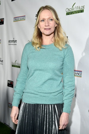 Actress Paula Malcomson showed her true colours in a mint green jumper.