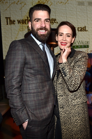 Zachary Quinto and actress Sarah Paulson. Red lips? Check. Statement coat? Check. We're sensing a trend here people.