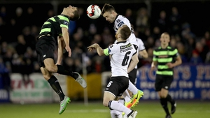 Dundalk's Robbie Benson and David McAllister of Rovers rise for  a header
