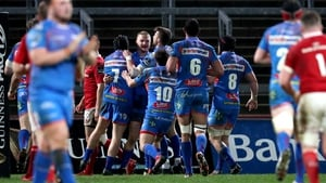 Johnny McNicholl is mobbed by his team-mates after scoring at Thomond Park