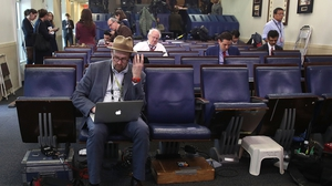 New York Times reporter Glenn Thrush works in the Brady Briefing Room after being excluded from a press briefing by White House Press Secretary Sean Spicer