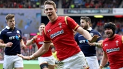 Wales' Liam Williams celebrates scoring the first try of the game