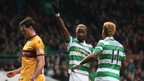 Moussa Dembele celebrates after scoring the opening goal