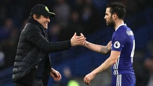 Antonio Conte congratulates Cesc Fabregas after the final whistle