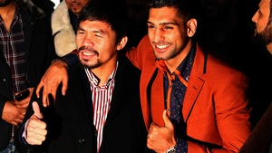 Amir Khan (R) wants to fight Manny Pacquiao (L) before hanging up his gloves