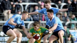Donegal's Eoghan Ban Gallagher is tackled by Dublin's John Small, Jack McCaffrey and Eric Lowndes