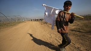 A displaced Iraqi boy from the Dindan neighbourhood in Mosul carries a white flag as he flees towards the Hammam al-Alil area