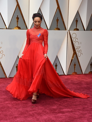 Our girl has arrived! Ruth Negga looks absolutely stunning in this Valentino red dress with jewellery by Irene Neuwirth for Gemfields.