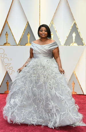 Nominee for Best Supporting Actress 'Hidden Figures' Octavia Spencer looks fabulous in a  feathery Marchesa.