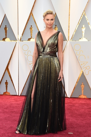 Charlize Theron opted for a thigh high split and plunging v-neck in this Christian Dior gown.
