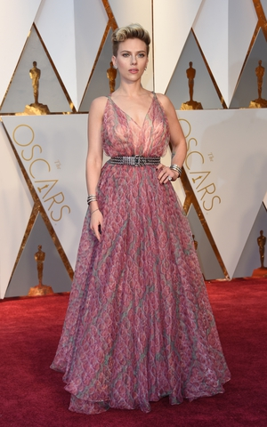 Scarlett Johansson in a soft floral Azzedine Alaia dress and studded belt.