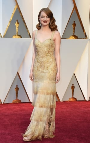 Oscar winner Emma Stone looked like a Hollywood Queen in this fringed  Givenchy Haute Couture and Tiffanny & Co. jewellery.