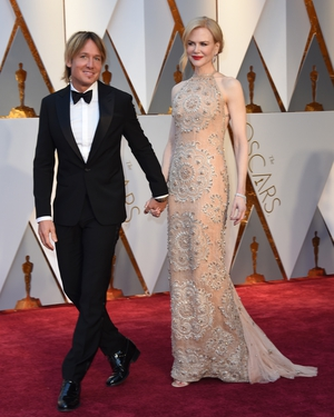 Nominee for Best Supporting Actress for 'Lion' Nicole Kidman wore Armani Privé and stepped out hand-in-hand with hubby Keith Urban.