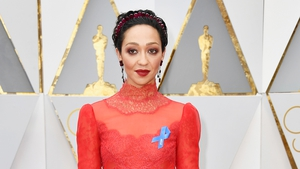 Loving nominee Ruth Negga was one of the first stars to arrive on the red carpet wearing the ACLU blue ribbon.
