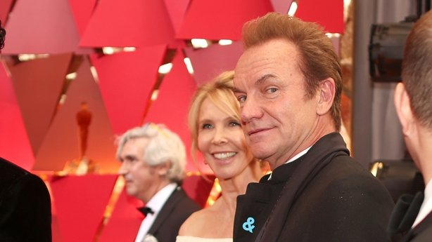 Trudie Styler & hubby Sting, sporting the ACLU blue ribbon