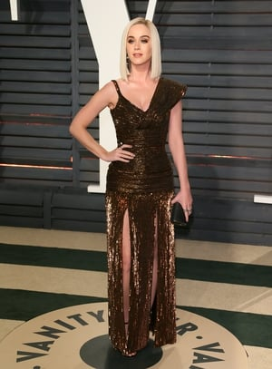 We are loving Katy Perry's blonde locks and metallic Jean Paul Gaultier gown.