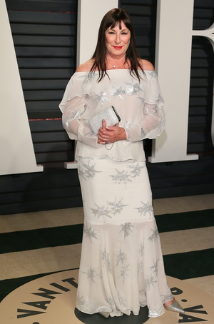 Anjelica Huston sparkles in silver stars.