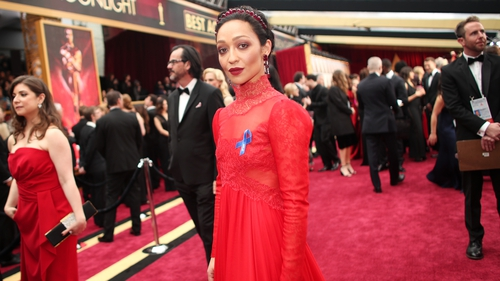 Ruth Negga wore a blue ACLU ribbon as she walked the red carpet