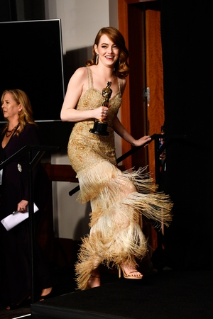 Emma Stone celebrates her best actress win