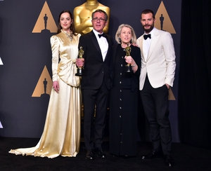 Dakota Johnson, production designer David Wasco and art director Sandy Reynolds-Wasco, winners of Best Production Design for La La Land and Jamie Dornan