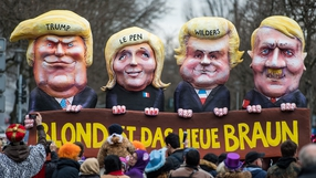 A float depicting Donald Trump, French far-right leader Marine Le Pen, Dutch MP Geert Wilders and Adolf Hitler with blond hair in Duesseldorf