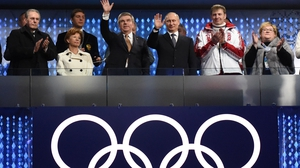 Russian President Vladimir Putin (3rd from right) at the Sochi 2014 closing ceremony