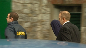 Ross Outram (hooded) arriving at court this morning