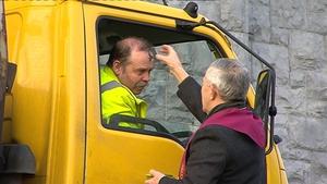 Fr Paddy Mooney blesses a motorist