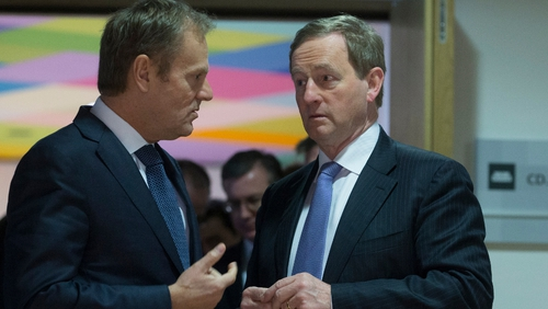 Donald Tusk (L) and Enda Kenny chat ahead of their meeting in Brussels