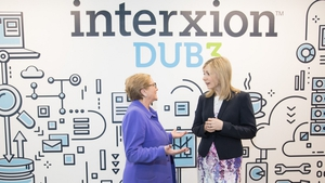 Tánaiste Frances Fitzgerald (L) speaks with Managing Director of Interxion Ireland Tanya Duncan (R)
