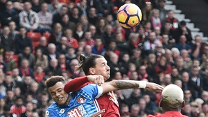 Zlatan Ibrahimovic clashes with Tyrone Mings in the 1-1 draw with Bournemouth