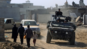 Iraqi forces patrol a street in Mosul during an offensive to retake the city from Islamic State fighters
