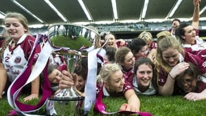 Slaughtneil's players celebrate with the Bill and Agnes Carroll Cup