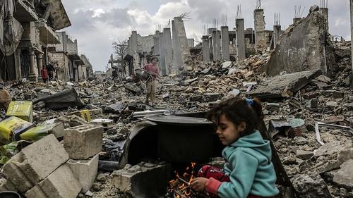 Kurdish Syrian girls among destroyed buildings in the Syrian Kurdish town of Kobane
