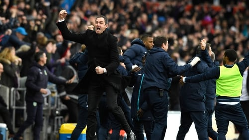 Paul Clement shows his delight after Swansea scored late to beat Burnley