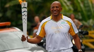 Frank Fredericks carrying the Olympic torch in Brazil last year