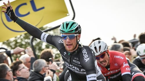Sam Bennett celebrates as he crosses the finish line ahead of John Degenkolb at the end of the 190 km third stage of Paris-Nice