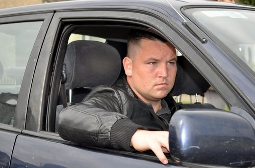 John Connors in a scene from Cardboard Gangsters