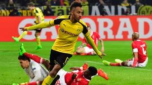 Pierre-Emerick Aubameyang celebrates scoring the last goal of the night in Dortmund