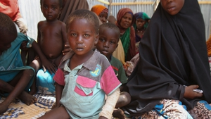 Somali children sit inside an IDP (internally displaced people) camp on the outskirts of Mogadishu, Somalia